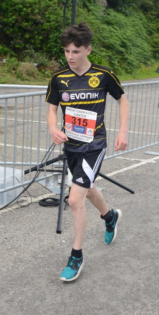 Elliot Gemmill crosses the line. to win the 5K.