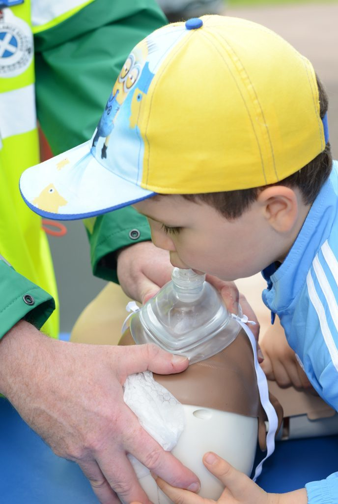 Young first aider Kyle Gosling, 5, givses the kiss of life to Resusci-Annie. 25_c26primaryfun04