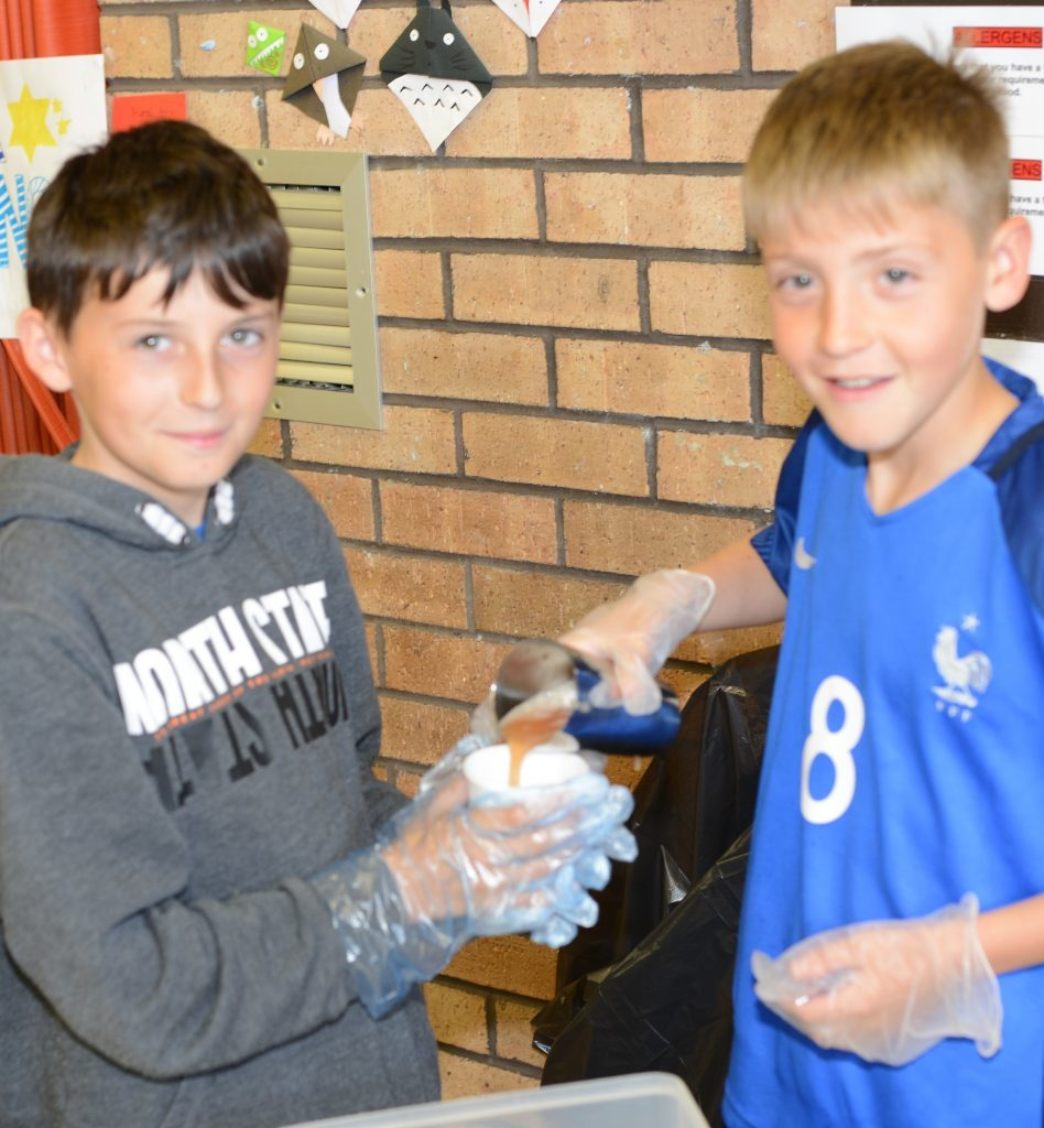 Scott McGeachy, 11 and Cameron McMillan, 10, served soft drinks. 25_c26primaryfun08