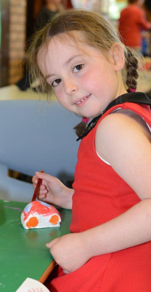 Mia Harper, 5, had fun painting an ornament. 25_c26primaryfun09