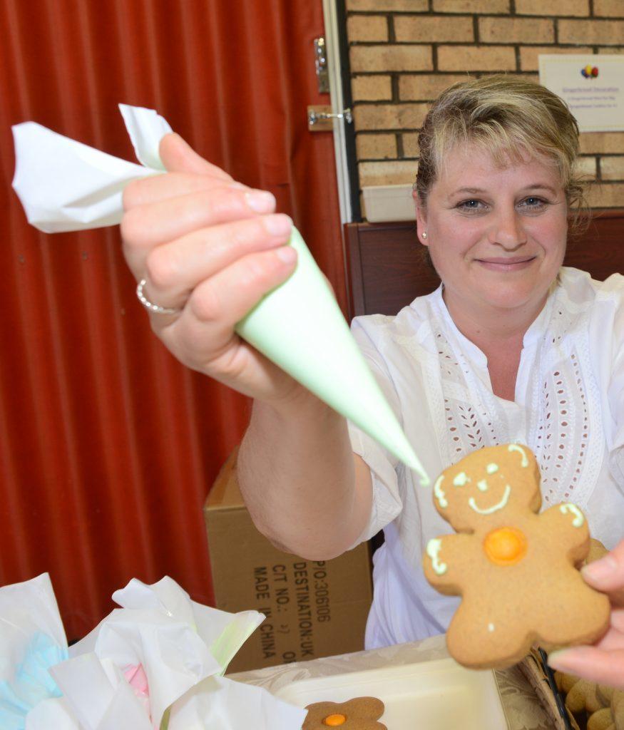 Zhanna Skrupska ran a stall for children to decorate gingerbread men. 25_c26primaryfun10