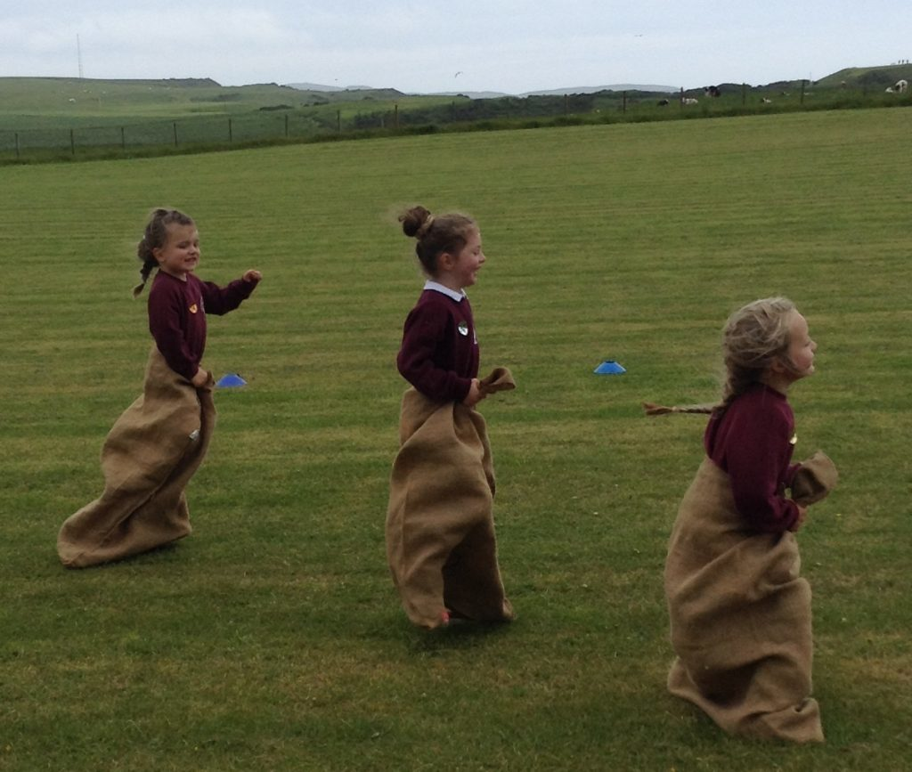 Youngsters are jumping for joy in the sack race. c26southend03no_sack race