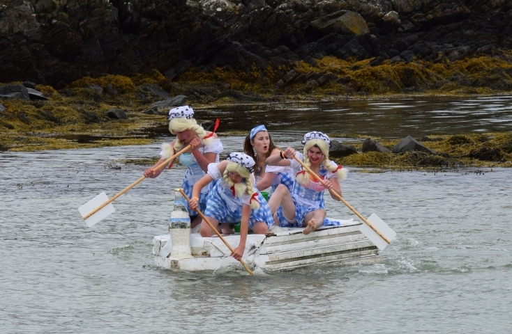 Teenage team, Wee Isle Maids, keeping an eye on the Baywatch team as they approach the shore. 50_c31gigha10_second place