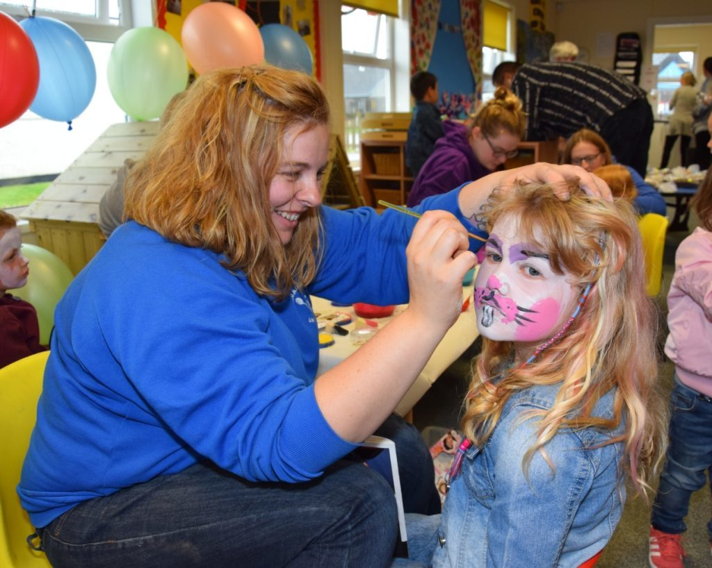Tracy MacLaren transforms Lily King, seven, into a bunny rabbit. 50_c31meadows02_face painting