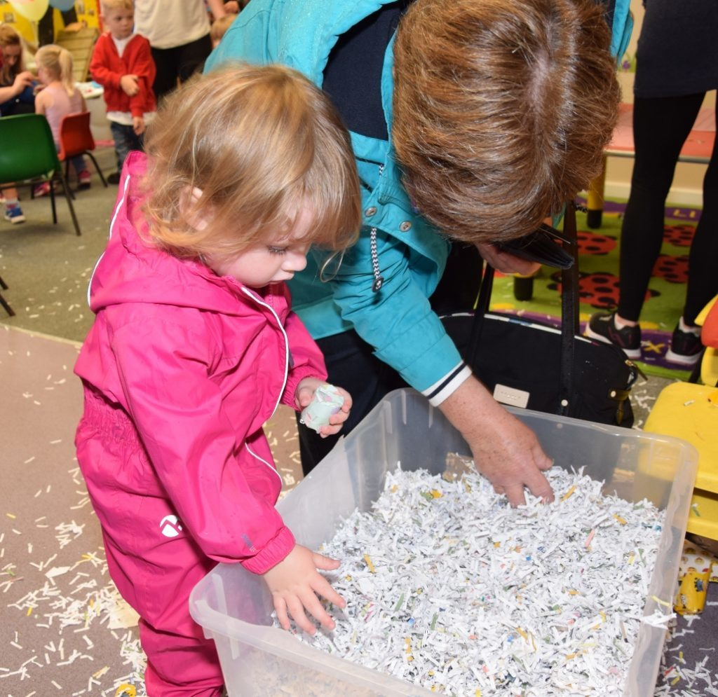 Mary Watson helps her grand-daughter Anna Watson, two, to find a lucky dip. 50_c31meadows06_lucky dip