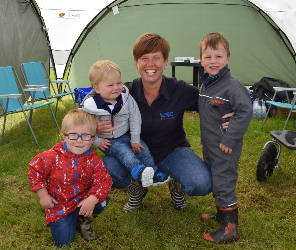 Catherine Reid, Kintyre area manager of Highland Fuels, being looked after by her nephews, Thomas Robertson, three, Archie Reid, one, and Jack Reid, three, of Glenside Tractors. 50_c32kintyreshow03_catherine reid