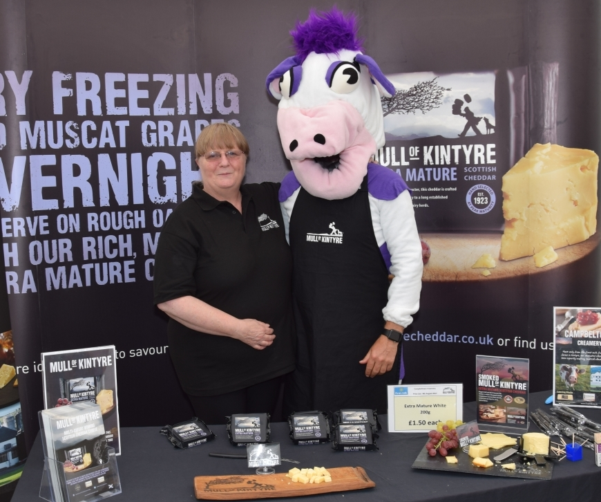 Campbell the cow helps Sheena Robertson run the Mull of Kintyre cheese stall. 50_c32kintyreshow06_mull of kintyre cheese