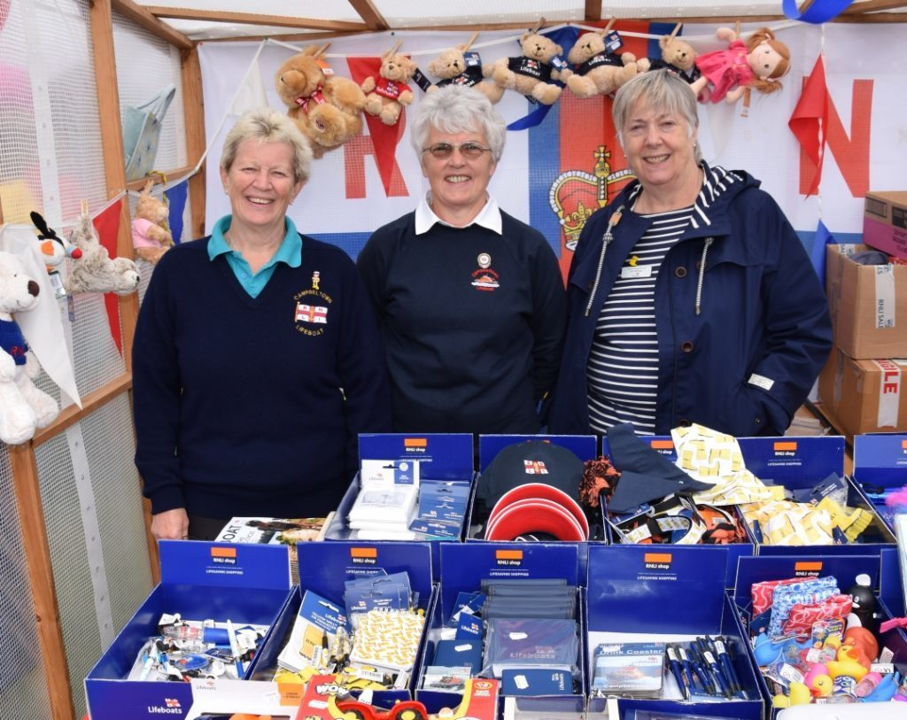 Marjorie Leighton, Margaret Bakes and volunteer shop manager, Sue Morgan, man the RNLI stand. 50_c32kintyreshow13_rnli