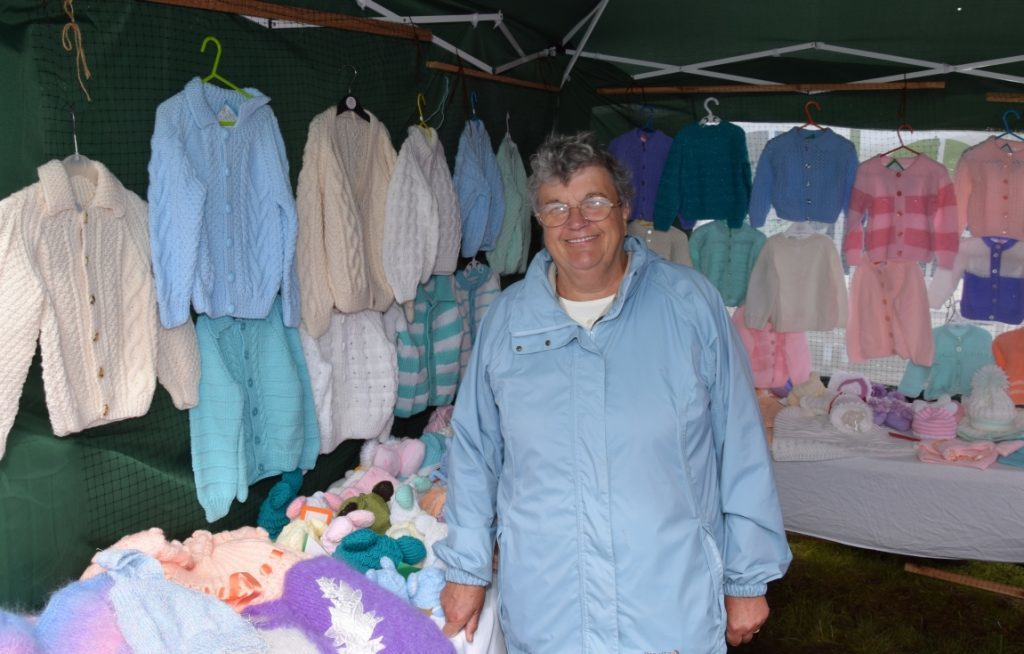 Catherine Blain from Dunoon helps run her daughter Lorna Hamilton's knitting stall. Catherine has been visiting Kintyre for more than 50 years, and the first time she came she was pregnant with Lorna. 50_c32kintyreshow21_knitting