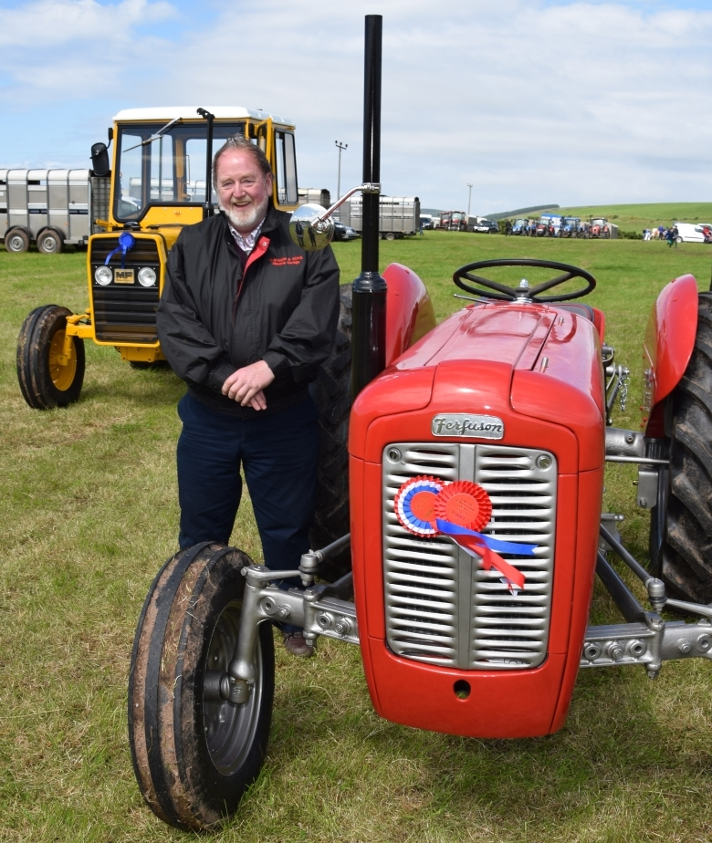DG Weir, from Arran, won the Society Quaich for best old tractor with his Massey Ferguson 35. 50_c32kintyreshow27_dg weir tractor