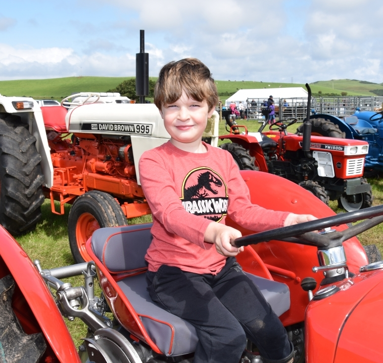Jake Rowan, six, has a seat on the award-winning tractor. 50_c32kintyreshow28_jake rowan