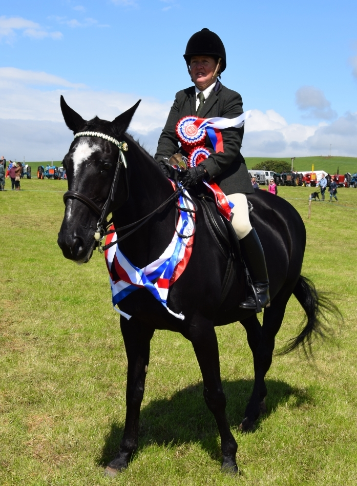 Heather Dixon, riding Blossom Hill, was the overall champion in the horse and pony section. 50_c32kintyreshow34_heather dixon