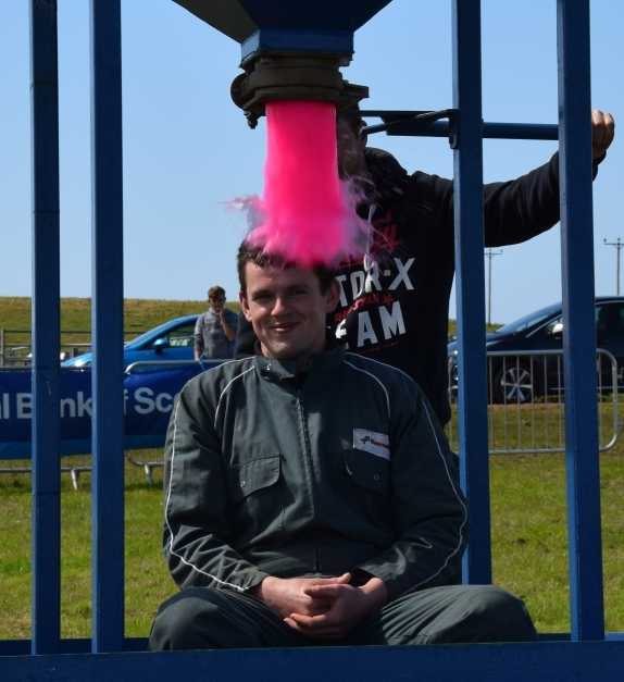 Campbeltown Young Farmers chairman, Robert MacKinnon, gets gunged after the group smashed their fundraising targets. 50_c32kintyreshow37_robert gunge