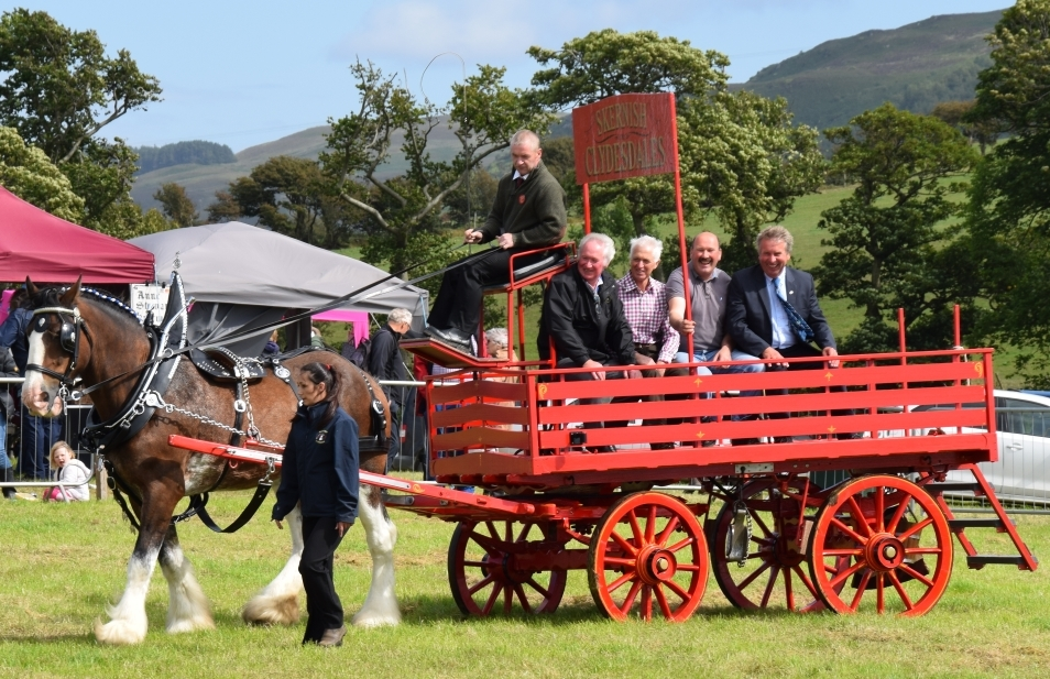 The winners of long service awards in recognition of their years of service to the farming community of Kintyre on a tour round the ring courtesy of Michael Mayberry. 50_c32kintyreshow56_long service tour