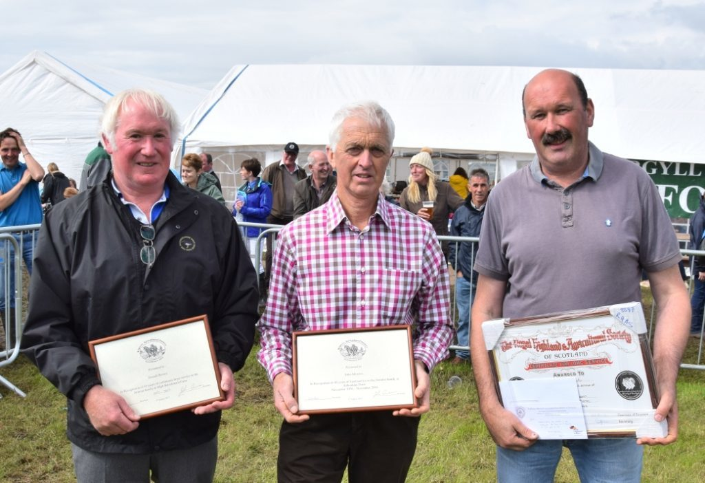 Donald Brown, John Menzies and Duncan Black with their certificates in recognition of their years of service to the farming community of Kintyre. 50_c32kintyreshow57_long service