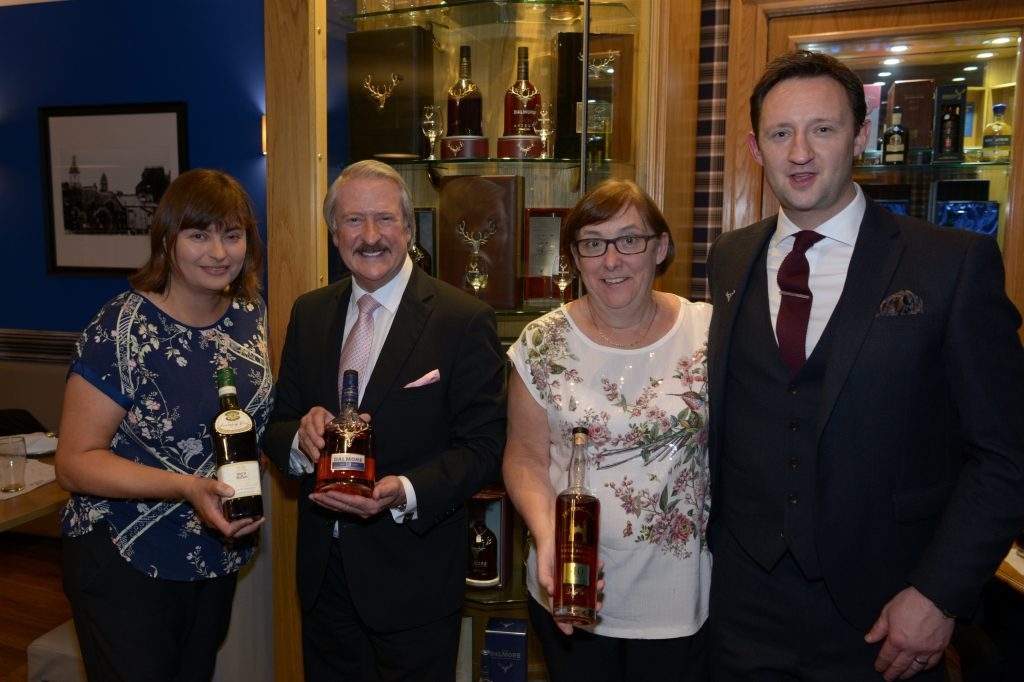 Marion McKinnon, Richard Paterson, Flora Grant and Scott Grierson in front of the Ardshiel Hotel's Dalmore cabinet
