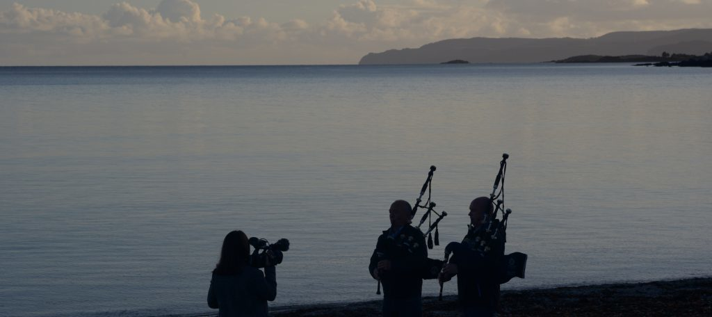 Clare McNeill films the two pipers.