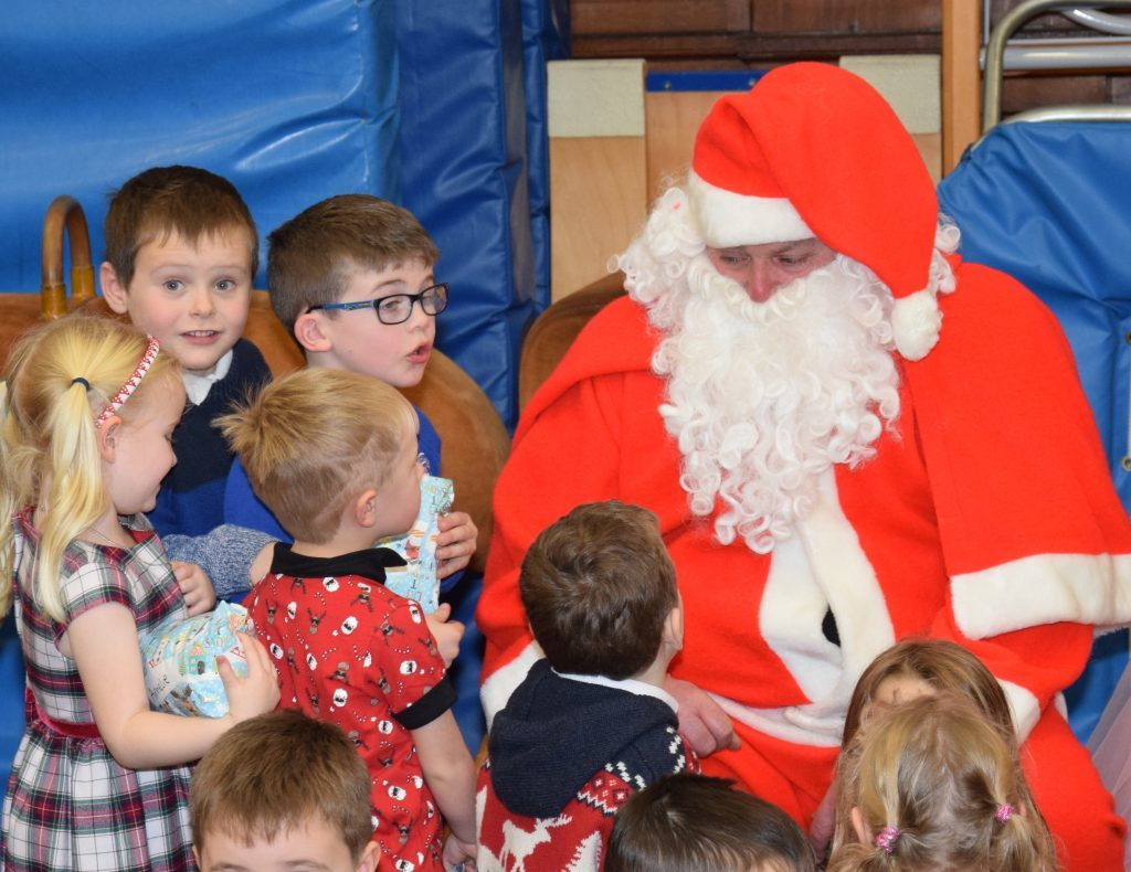 Some of the children in awe of Santa. 50_c51castlehill01