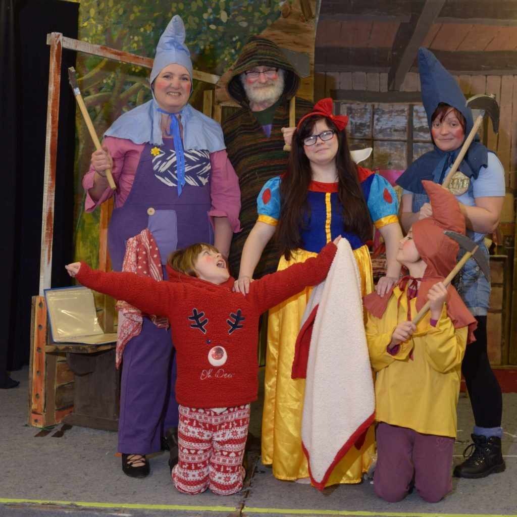 Snow White (Kayleigh McNeill) centre with five available dwarfs from back left: Snotters (Kirsti Paisley), Prof (Peter Simpson), Beamer (Lesley Norris), Snoozy (Grace Norris) and Joyful (Daisey Brown). 25_c04calamities07