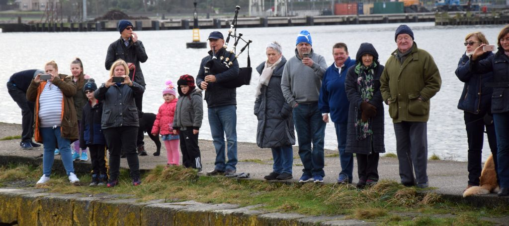 Spectators watching the dip, with piper Ian Mckerral were well wrapped up. 50_c01dipfordosh01