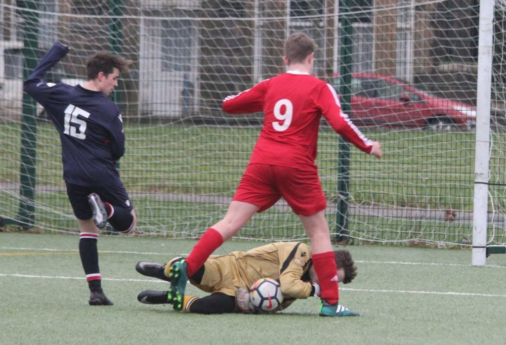 A Pupils goal is thwarted by the Saints keeper. NO_c03pupils03