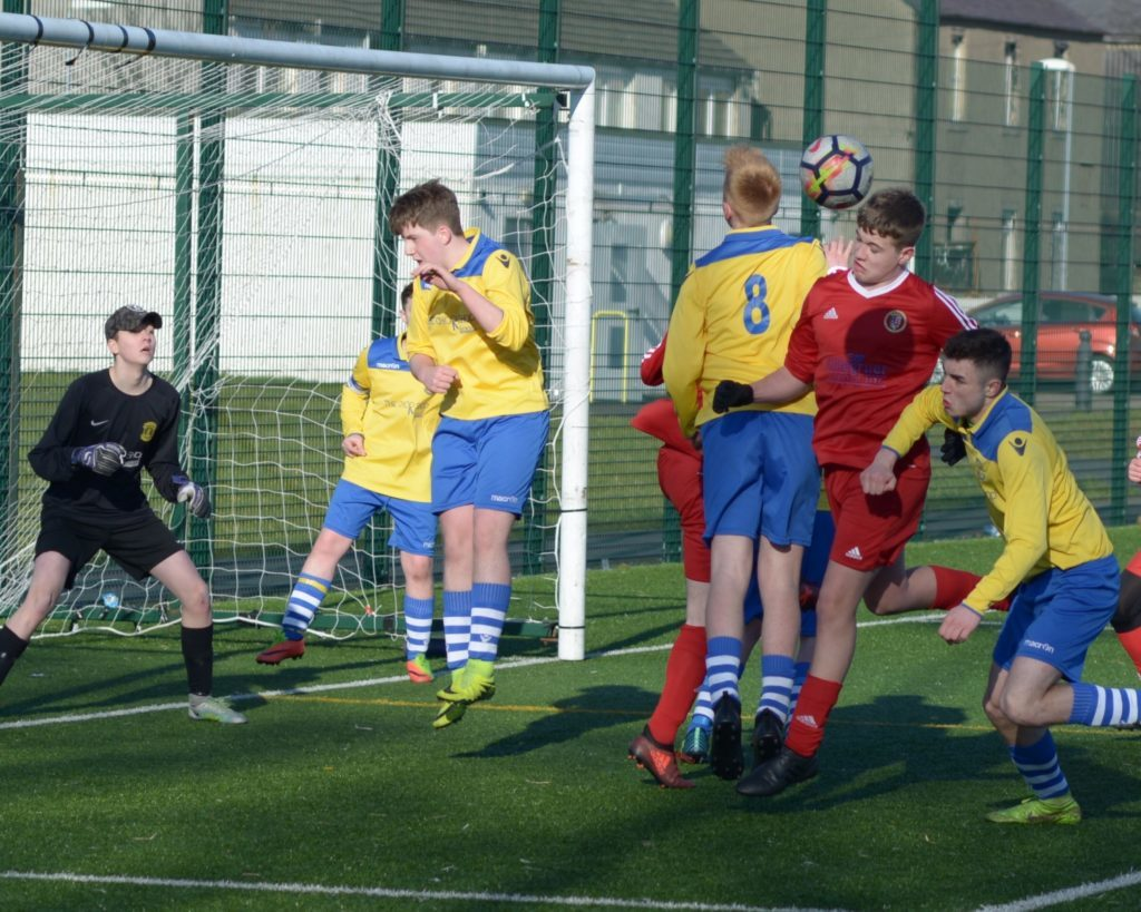 Pupils final attack on the Dunoon goal.