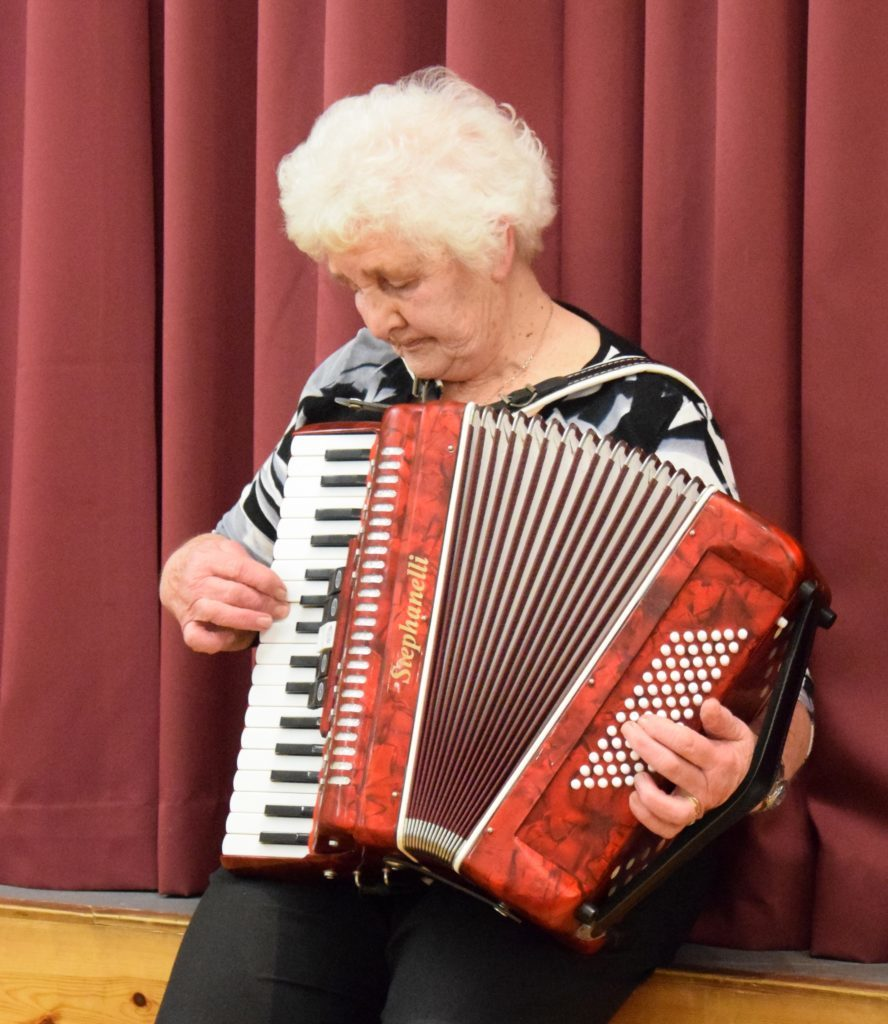 Helen Steel played her accordion. 50_c06churchsupper06_helen steel