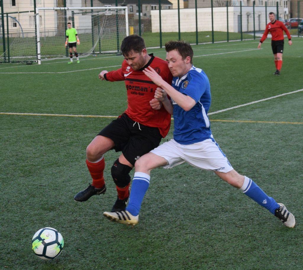 Donald McCallum fights for possession of the ball. 50_c06pupils02_donald mccallum