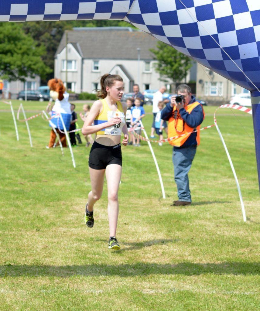 Ella McGregor crosses the line