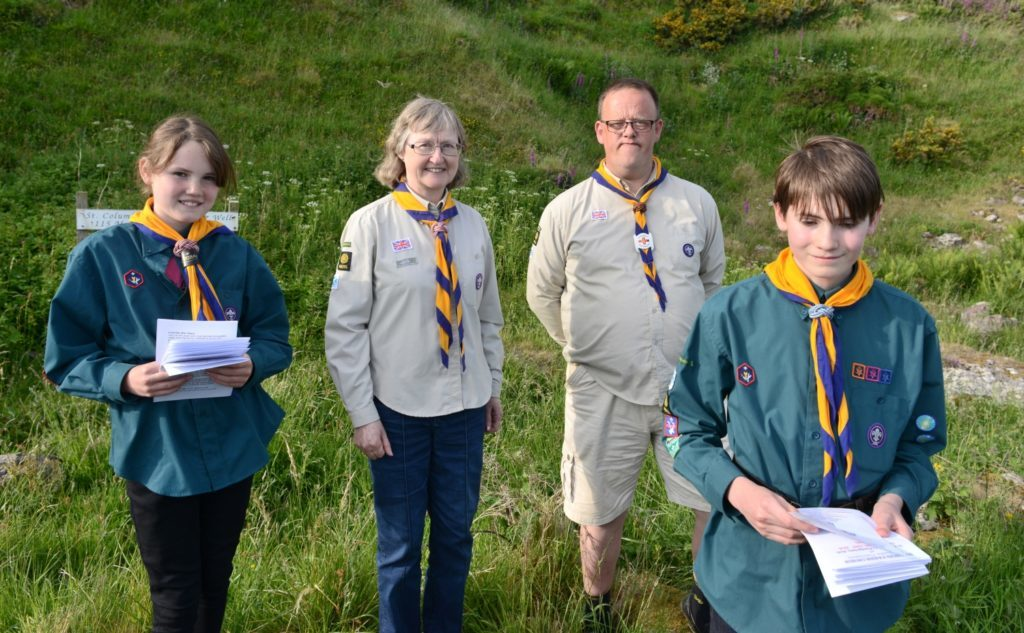 4th Argyll scouts handed out order of service brochures. From left: Emma Barbour, Jean Ives, Stephen Chinn and Ruairi Barbour.