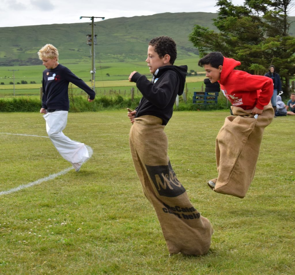Jumping for joy: boys compete in the sack race.