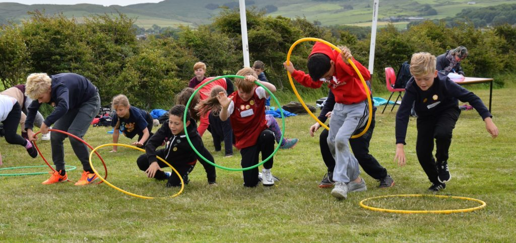 Jumping through hoops: boys compete in the obstacle course.
