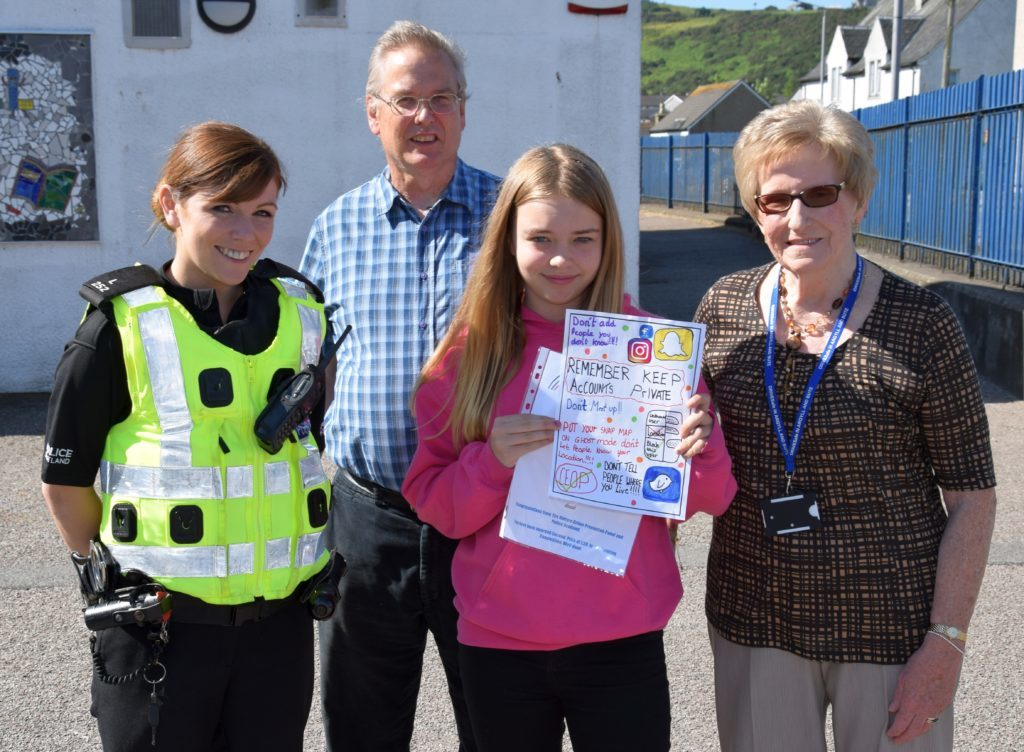 Jenna Robertson, of Castlehill Primary School, pictured with PC Karen Cairns, Andrew Hemmings and Eva MacDonald, took second place.