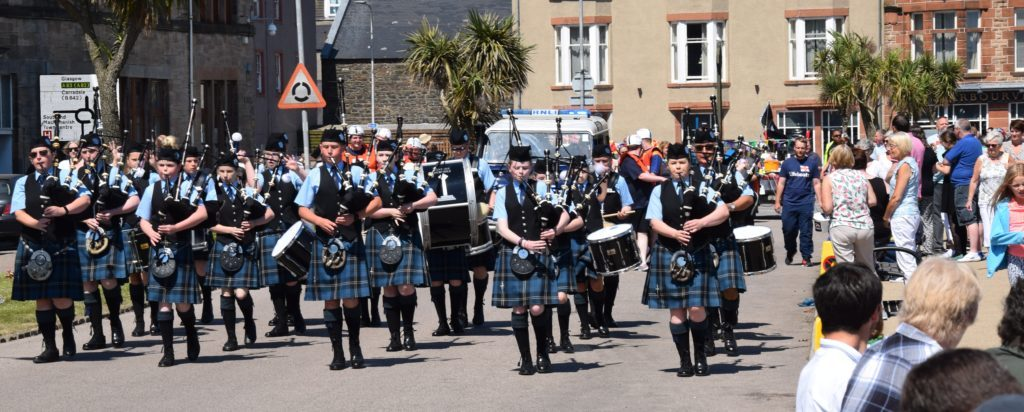 The pipe band led the raft parade along Hall Street.