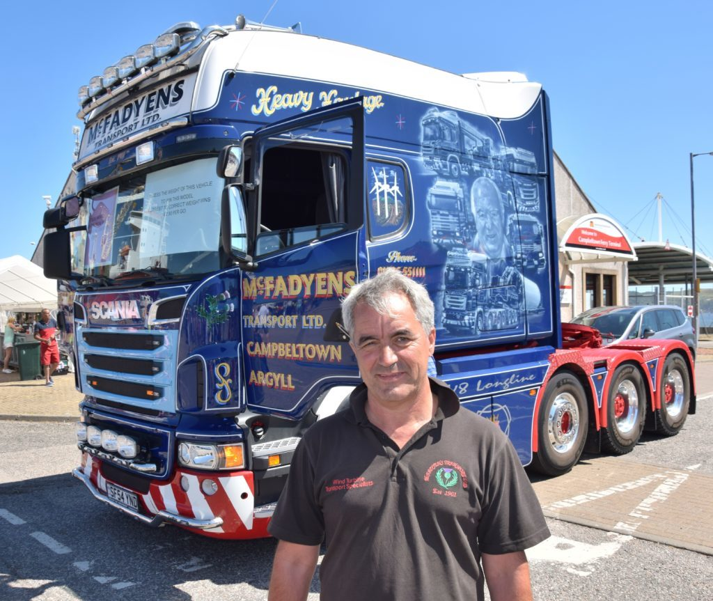 Calum McFadyen challenged people to guess the weight of a lorry painted in honour of his father, Charlie McFadyen, to win a model of the vehicle.