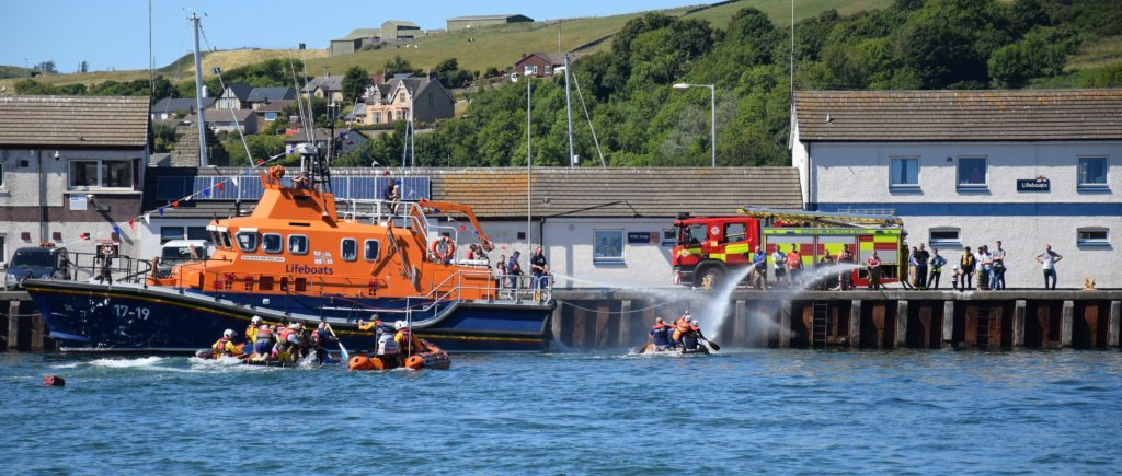 Both the all-weather lifeboat and the fire engine gave competitors a soaking in the final.