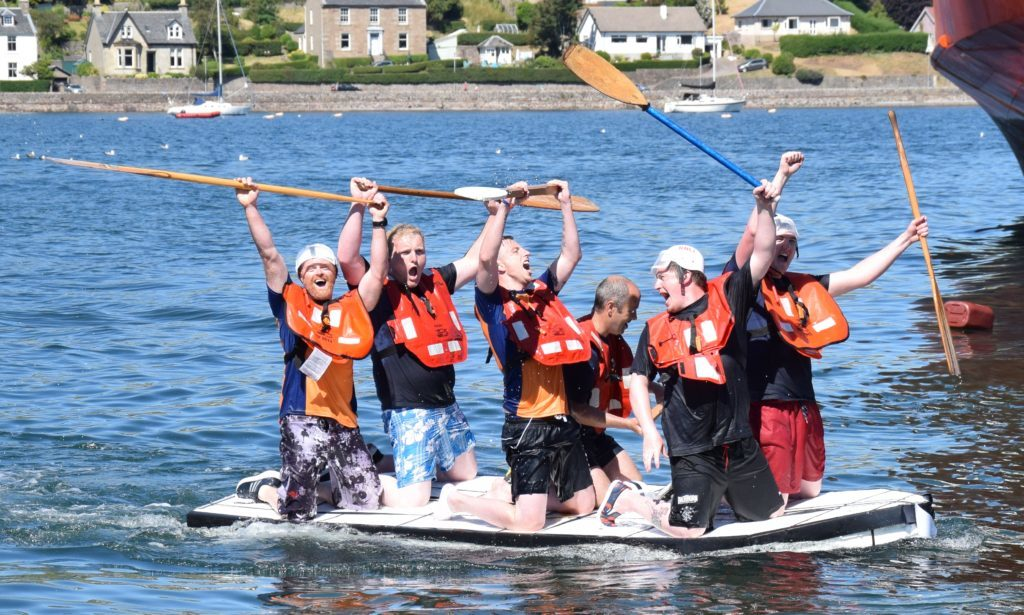 Celebrations as the RNLI raft crosses the line.
