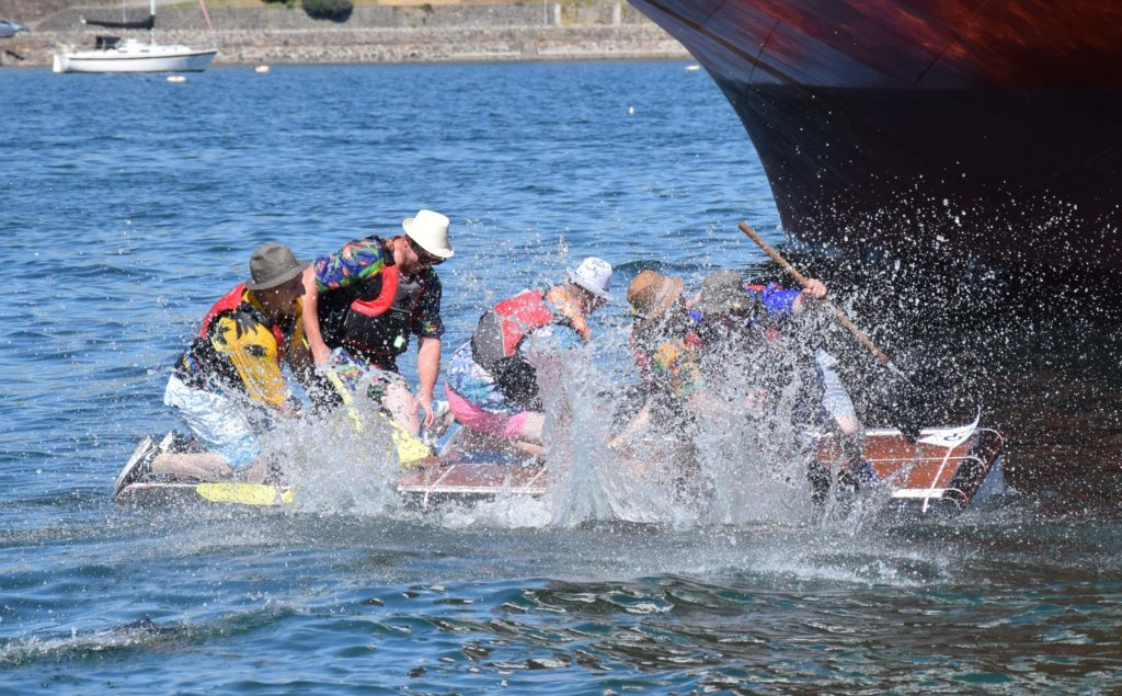 Even coming third, Calum McKinven's raft celebrated with the traditional jump into the sea.