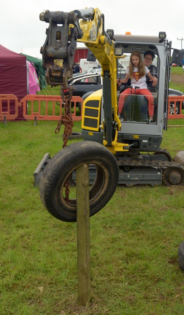 ​Yasmin Howseman, 11, with a bit of hinderance from her mum Rachel Howseman have a go at Campbeltown Young Farmers' digger challenge. 25_c32kasshow13_digger_challenge