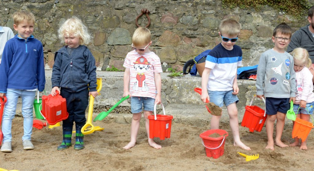 Ready to build their sandcastles were from left: Finlay Blair, Austin Peet, Matthew Strudwick, Samuel Strudwick, Jack McCullough and Maisie McCullough. 25_c32regatta05_ready_to_build