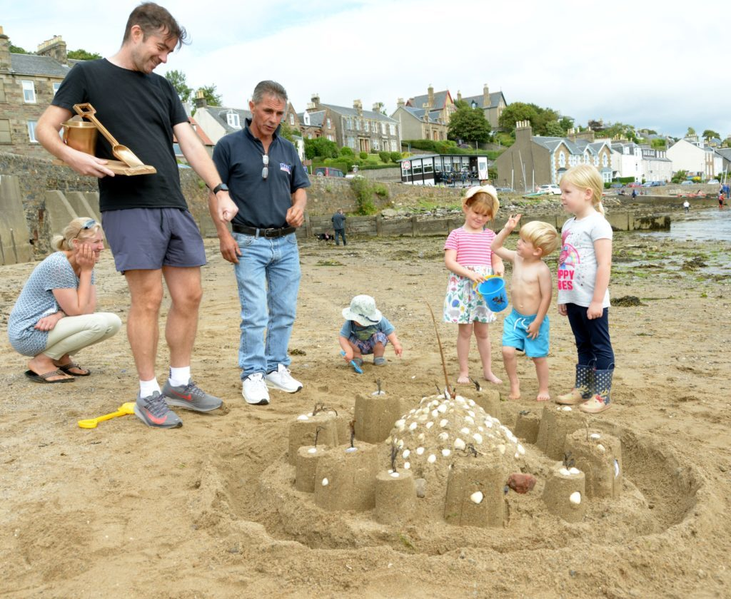 These castle builders shelled out.  25_c32sandcastles03