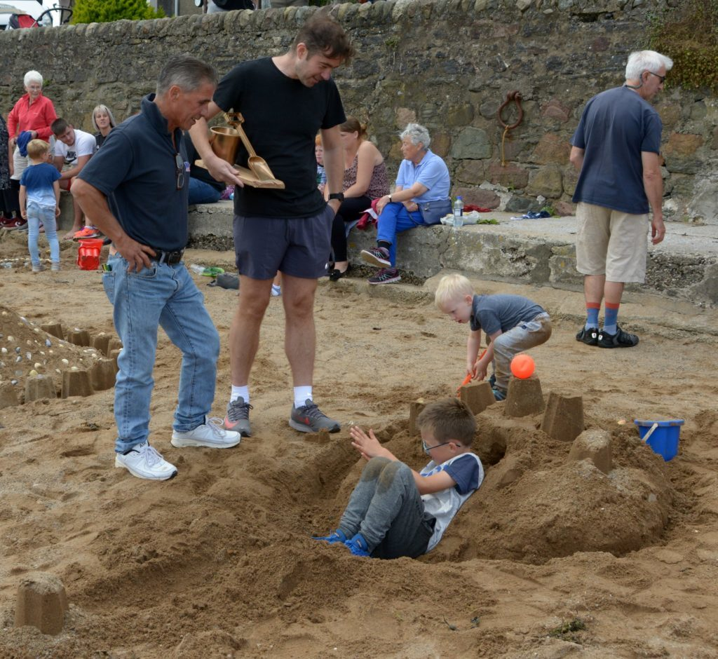A castle with ongoing construction. 25_c32sandcastles11_ongoing construction