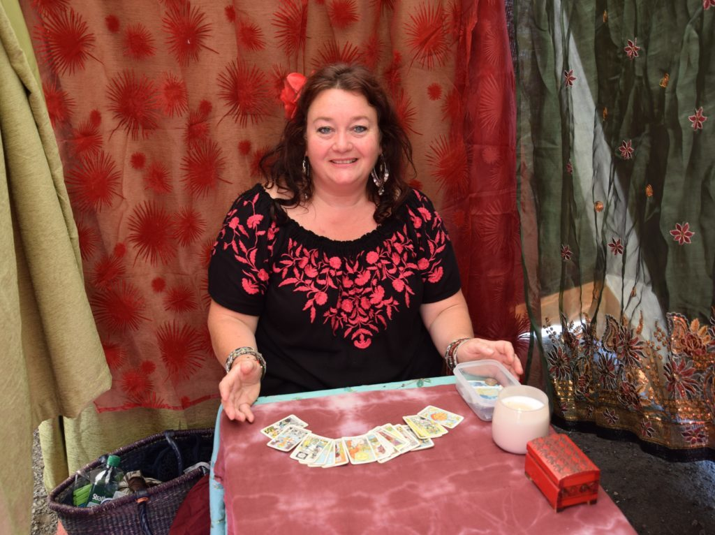 Fortune teller Eleanor Sloan read tarot cards inside a sweltering tent.