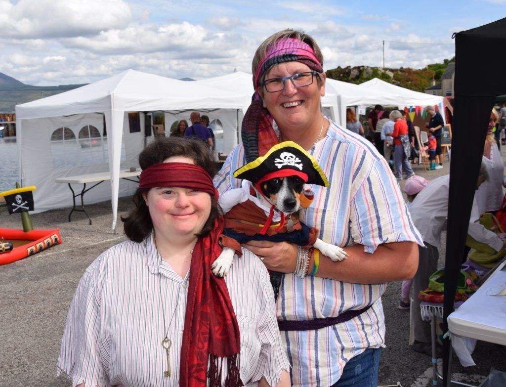 Pirates Jenna Campbell and Trish Collins pose with Trish's pirate dog Minni.