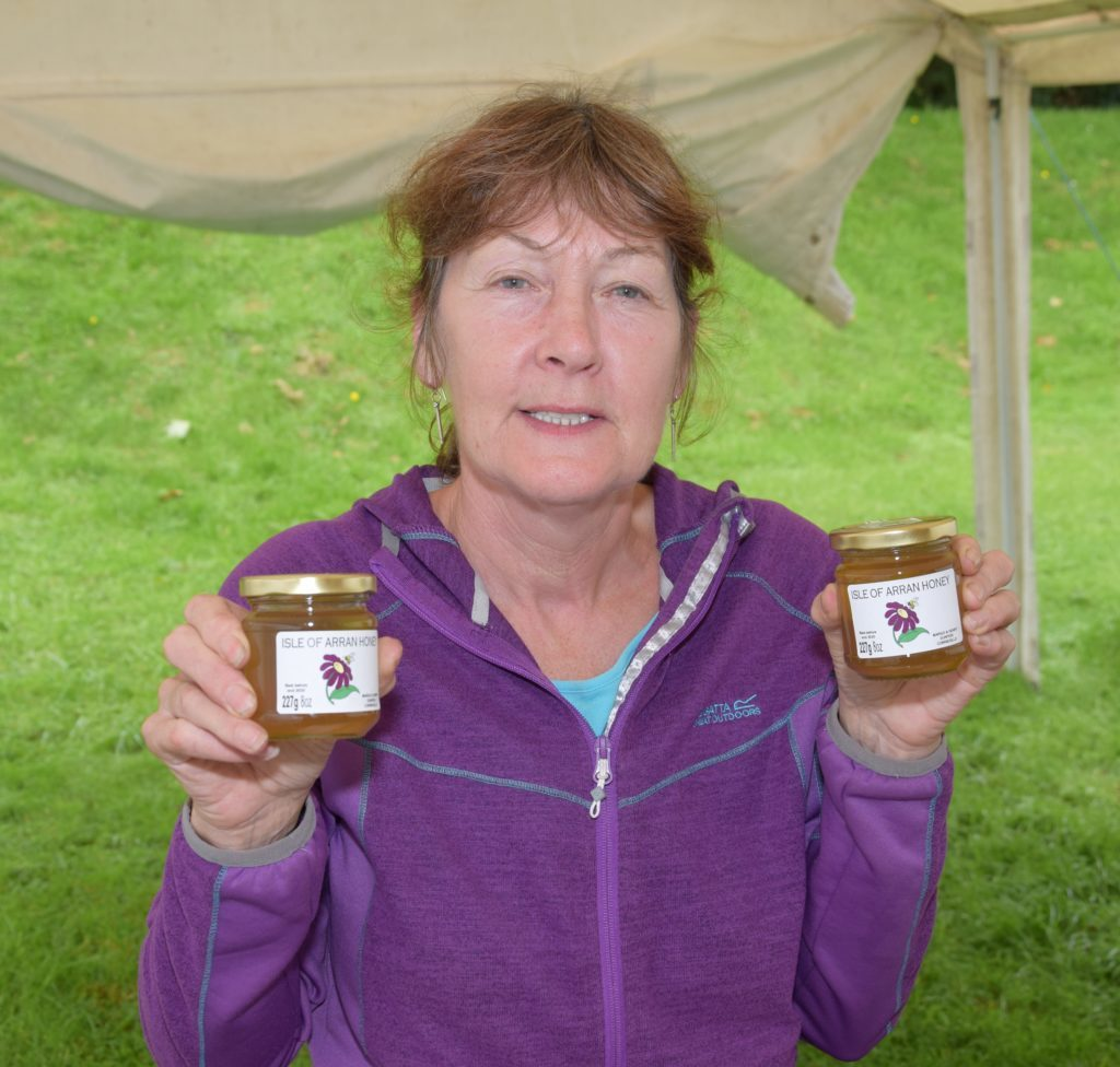 Margo McLellan travelled overseas to bring Isle of Arran honey to the event.