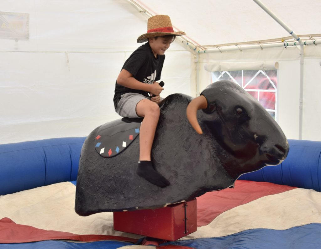 12-year-old Raphael MacLachlan takes on the bucking bronco.