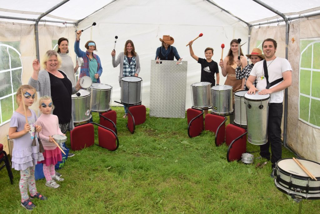 Mark MacSporran, right, teaches the art of samba drumming to people of all ages.