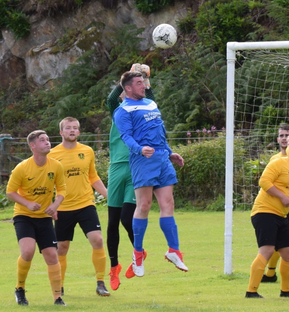 Robert McGarrie battles to keep the ball clear of the goal.