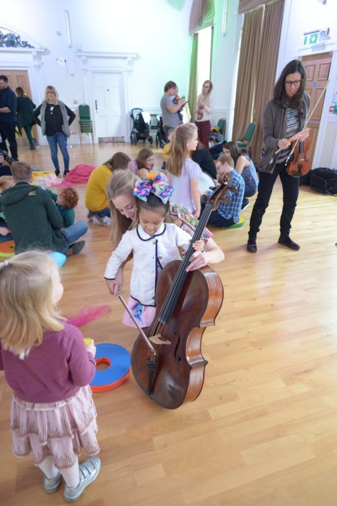 Isla Crane, 3, tries the cello.