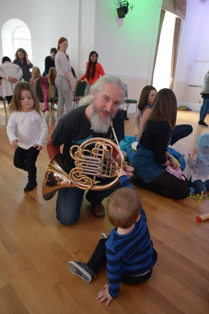 Fergus Kerr demonstrates his French horn.